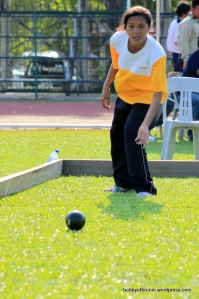 Girl Playing Bocce